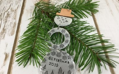 Metal stamping jewelry is in full swing, check out this Snowman!